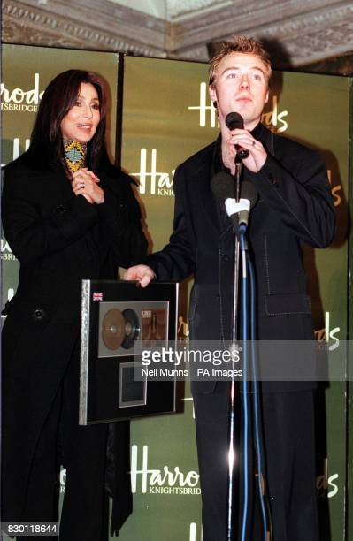 Singer Cher at the Harrods store in Knightsbridge London with 'Boyzone' singer Ronan Keating who presented her with a Gold Disc after she officially...