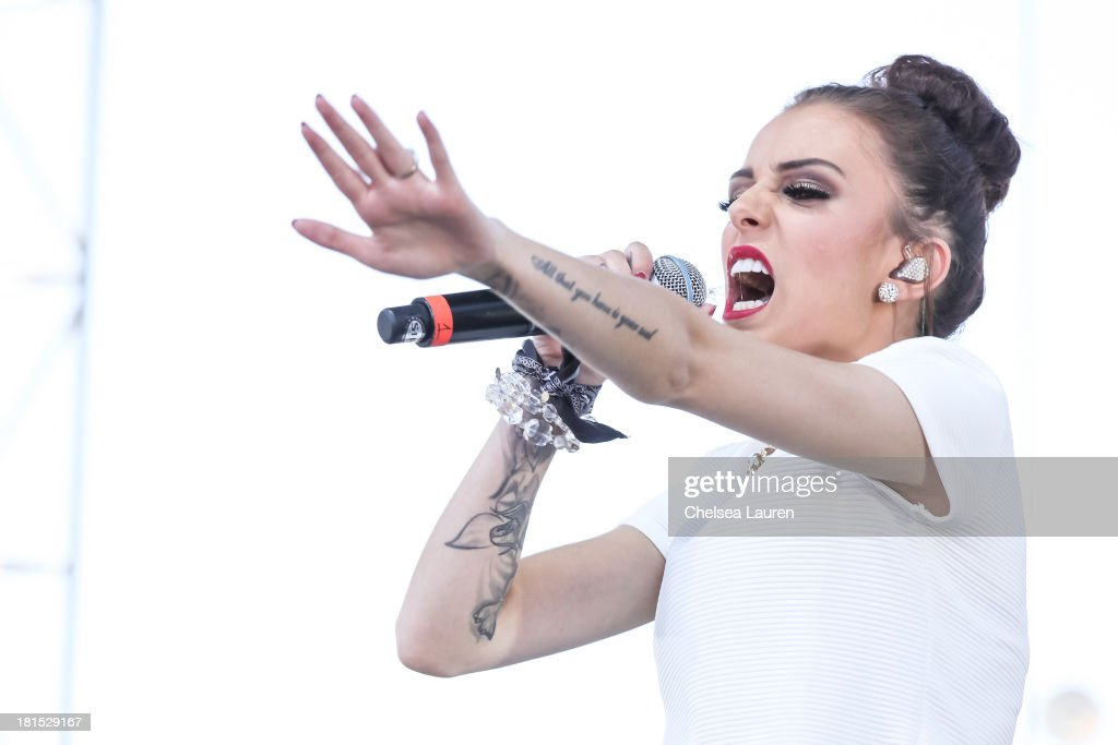 Singer <a gi-track='captionPersonalityLinkClicked' href=/galleries/search?phrase=Cher+Lloyd&family=editorial&specificpeople=7229738 ng-click='$event.stopPropagation()'>Cher Lloyd</a> performs at The Village during the iHeartRadio music festival on September 21, 2013 in Las Vegas, Nevada.