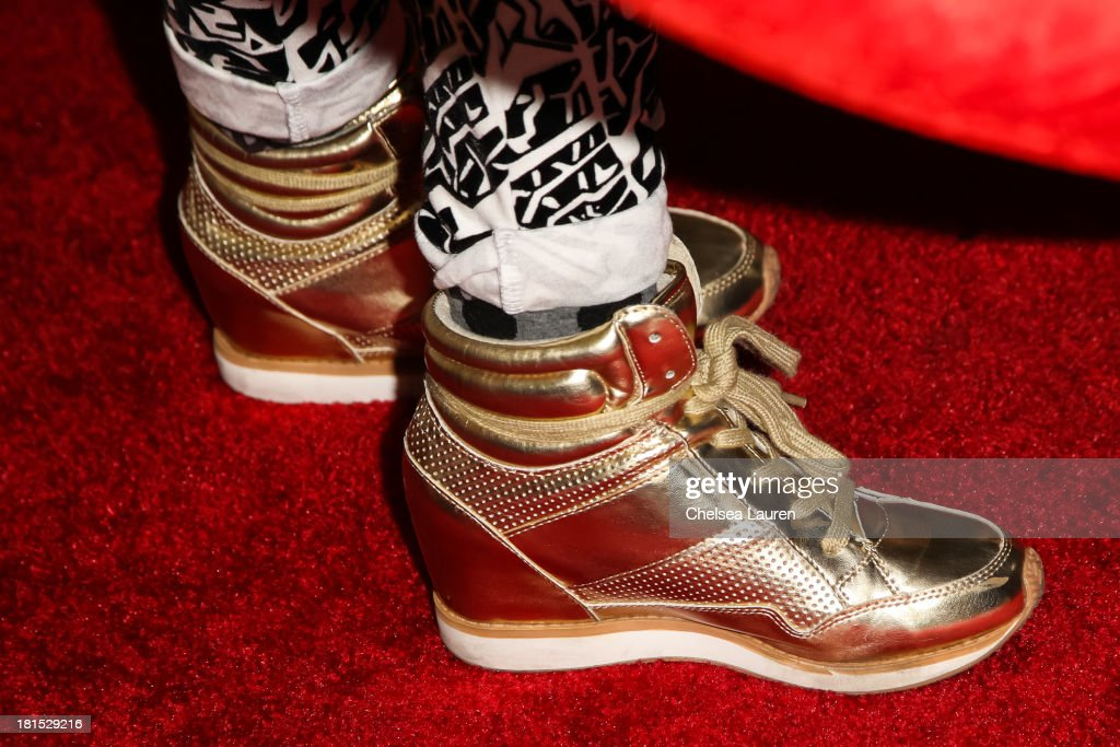 Singer Cher Lloyd (shoe detail) poses backstage at The Village during the iHeartRadio music festival on September 21, 2013 in Las Vegas, Nevada.