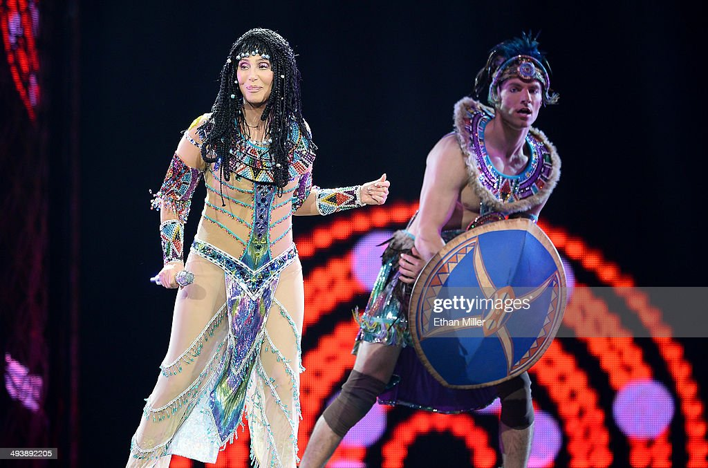 Singer Cher (L) performs with a dancer at the MGM Grand Garden Arena during her Dressed to Kill tour on May 25, 2014 in Las Vegas, Nevada.