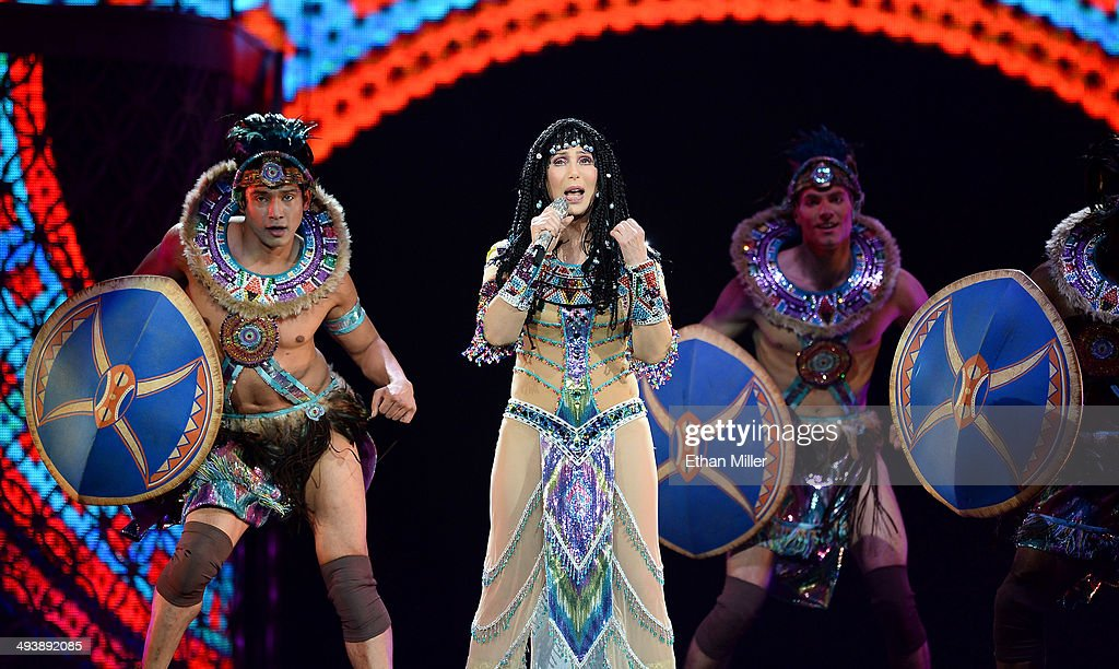 Singer Cher (C) performs with dancers at the MGM Grand Garden Arena during her Dressed to Kill tour on May 25, 2014 in Las Vegas, Nevada.