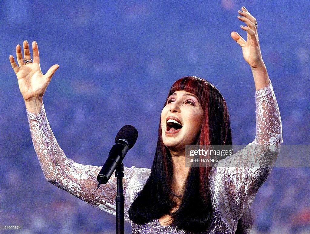 US singer Cher sings the 'Star Spangled Banner' before the start of Super Bowl XXXIII 31 January at Pro Player Stadium in Miami, FL. The Denver Broncos and Atlanta Falcons are playing for the Lombardi Trophy, the symbol of the NFL champions.