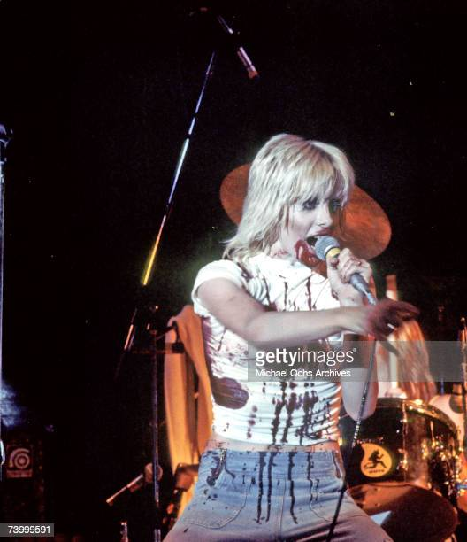 Singer Cherie Currie of the rock band 'The Runaways' performs on stage with blood on her in 1976 in Los Angeles CA