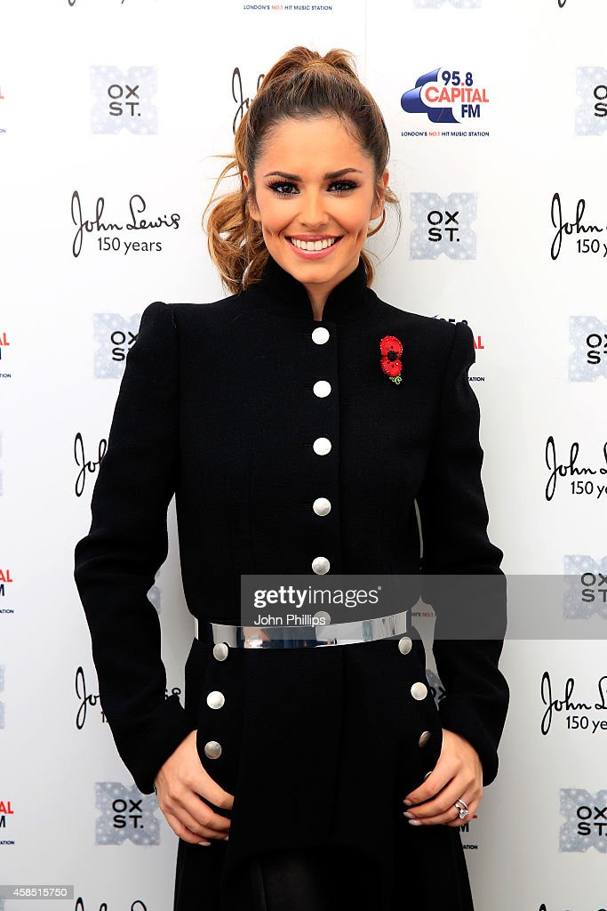 Singer <a gi-track='captionPersonalityLinkClicked' href=/galleries/search?phrase=Cheryl+Fernandez-Versini&family=editorial&specificpeople=202198 ng-click='$event.stopPropagation()'>Cheryl Fernandez-Versini</a> poses ahead of The World Famous Oxford Street Christmas Lights Switch On Event taking place at John Lewis' Flagship Store on November 6, 2014 in London, England.