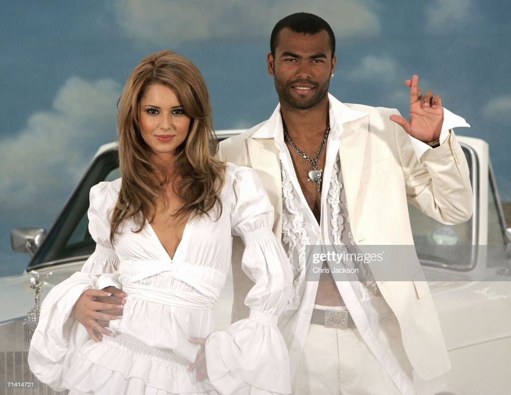 Singer Cheryl Tweedy of Girls Aloud and Footballer Ashley Cole pose in front of a Rolls Royce as they promote National Lottery's new Dream Number in Jasmine Studios on July 11, 2006 in London, England. Players can try to match all seven digits of their Dream Number ? in order from left to right ? with the seven numbers drawn in a twice-weekly draw.
