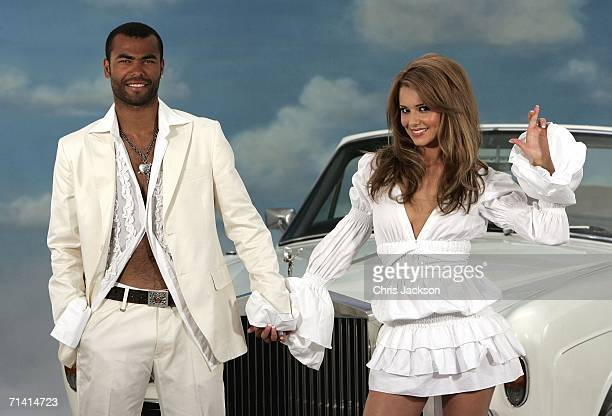 Singer Cheryl Tweedy of Girls Aloud and Footballer Ashley Cole pose in front of a Rolls Royce as they promote National Lottery's new Dream Number in...