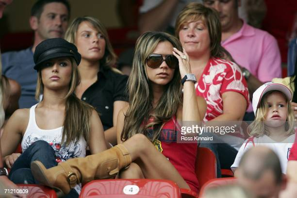 Singer Cheryl Tweedy the girlfriend of Ashley Cole Victoria Beckham the wife of England Captain David Beckham and their son Romeo attend the FIFA...
