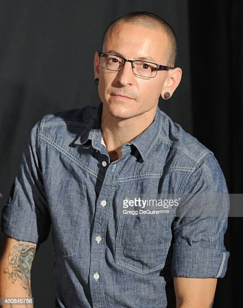 Singer Chester Bennington attends Linkin Park's induction into the Rockwalk at Guitar Center on June 18 2014 in Hollywood California