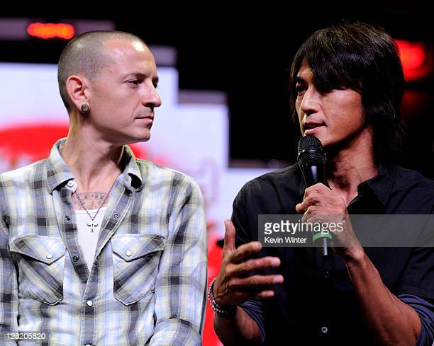 Singer Chester Bennington of Linkin Park and Koshi Inaba of B'z appear at a press conference to announce that fans raised over $350000 to benefit...