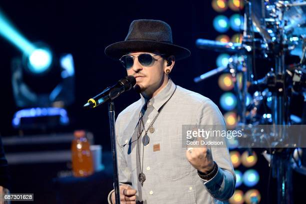 Singer Chester Bennington of Linkin Park performs onstage during the band's 'One More Light' album release party at the iHeartRadio Theater on May 22...