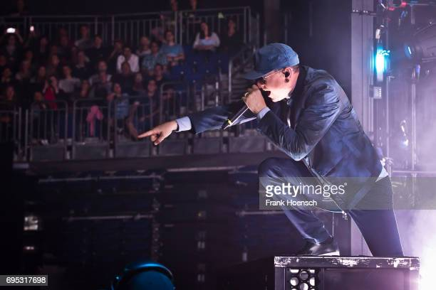 Singer Chester Bennington of the American band Linkin Park performs live on stage during a concert at the MercedesBenz Arena on June 12 2017 in...