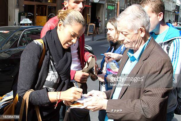 Singer Chimene Badi signs autographs as she arrives at L'Olympia on September 19 2012 in Paris France