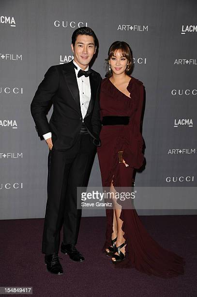 Singer Choi Si Won and guest arrive at LACMA Art Gala at LACMA on October 27 2012 in Los Angeles California