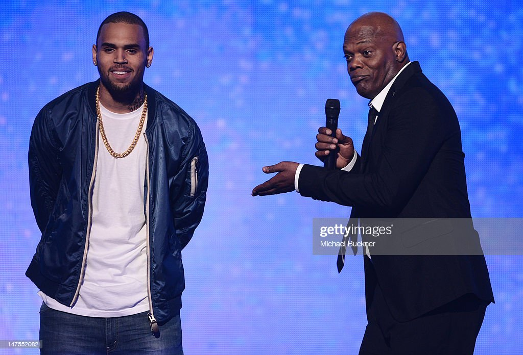 Singer Chris Brown accepts the Fandemonium Award from Host <a gi-track='captionPersonalityLinkClicked' href=/galleries/search?phrase=Samuel+L.+Jackson&family=editorial&specificpeople=167234 ng-click='$event.stopPropagation()'>Samuel L. Jackson</a> onstage during the 2012 BET Awards at The Shrine Auditorium on July 1, 2012 in Los Angeles, California.