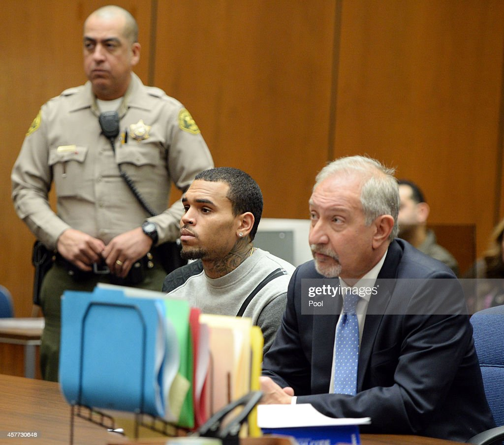 Singer Chris Brown and attorney Mark Geragos attend a progress hearing at Los Angeles Superior Court on October 23 2014 in Los Angeles California...