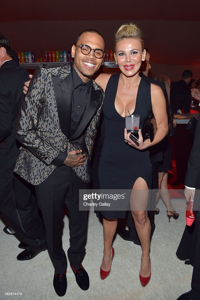 Singer Chris Brown (L) and Chairman and Founder of Neuro Diana Jenkins attends Neuro at 21st Annual Elton John AIDS Foundation Academy Awards Viewing Party at West Hollywood Park on February 24, 2013 in West Hollywood, California.