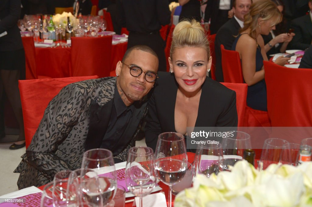 Singer Chris Brown (L) and Chairman and Founder of Neuro Diana Jenkins attend Neuro at 21st Annual Elton John AIDS Foundation Academy Awards Viewing Party at West Hollywood Park on February 24, 2013 in West Hollywood, California.