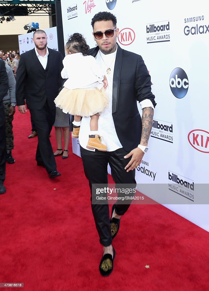 Singer Chris Brown and daughter Royalty attend the 2015 Billboard Music Awards with Kia Motors at MGM Grand Garden Arena on May 17 2015 in Las Vegas...