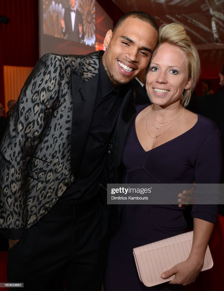 Singer Chris Brown (L) and guest attend the 21st Annual Elton John AIDS Foundation Academy Awards Viewing Party at West Hollywood Park on February 24, 2013 in West Hollywood, California.