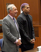 Singer Chris Brown and his lawyer Mark Geragos attend a progress hearing at Los Angeles Superior Court on MARCH 20 2015 in Los Angeles California The...