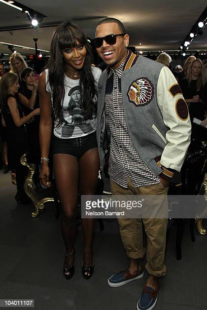 Singer Chris Brown and Naomi Campbell attend the Dolce Gabbana celebration of Fashion's Night Out at Dolce Gabbana Boutique on September 10 2010 in...