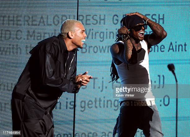 Singer Chris Brown and rapper Lil Wayne accept the Best Collaboration award onstage during the BET Awards '11 held at the Shrine Auditorium on June...