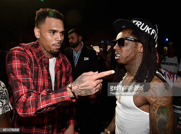 Singer Chris Brown and rapper Lil Wayne attend the BET AWARDS '14 at Nokia Theatre LA LIVE on June 29 2014 in Los Angeles California