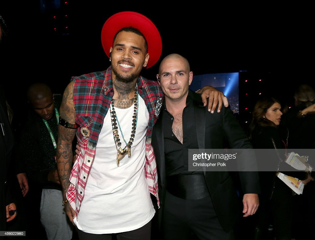 Singer <a gi-track='captionPersonalityLinkClicked' href=/galleries/search?phrase=Chris+Brown+-+Singer&family=editorial&specificpeople=4452016 ng-click='$event.stopPropagation()'>Chris Brown</a> (L) and rapper <a gi-track='captionPersonalityLinkClicked' href=/galleries/search?phrase=Pitbull+-+Rapper&family=editorial&specificpeople=206389 ng-click='$event.stopPropagation()'>Pitbull</a> attend the 15th Annual Latin GRAMMY Awards at the MGM Grand Garden Arena on November 20, 2014 in Las Vegas, Nevada.