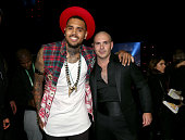 Singer Chris Brown and rapper Pitbull attend the 15th Annual Latin GRAMMY Awards at the MGM Grand Garden Arena on November 20 2014 in Las Vegas Nevada