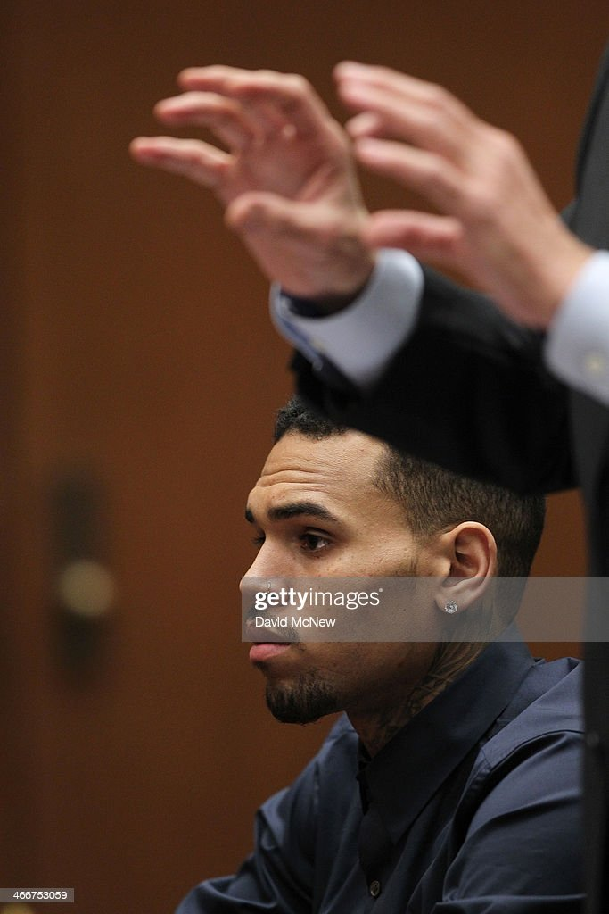 R&B singer Chris Brown appears in court as his attorney <a gi-track='captionPersonalityLinkClicked' href=/galleries/search?phrase=Mark+Geragos&family=editorial&specificpeople=201725 ng-click='$event.stopPropagation()'>Mark Geragos</a> gestures during a probation progress hearing on February 3, 2014 in Los Angeles, California. Brown has been on probation since pleading guilty to assaulting his then girlfriend, singer Rihanna, after a pre-Grammy Awards party in 2009. He has been in anger management treatment program and performing community service requirements but failure to meet probation requirements could be even further complicated by assault charges he and bodyguard Christopher Hollosy face stemming from an incident outside the W hotel in Washington D.C. last October.