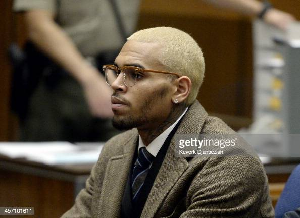 B singer Chris Brown appears in court for a probation violation hearing during which his probation was revoked by a Los Angeles Superior judge on...