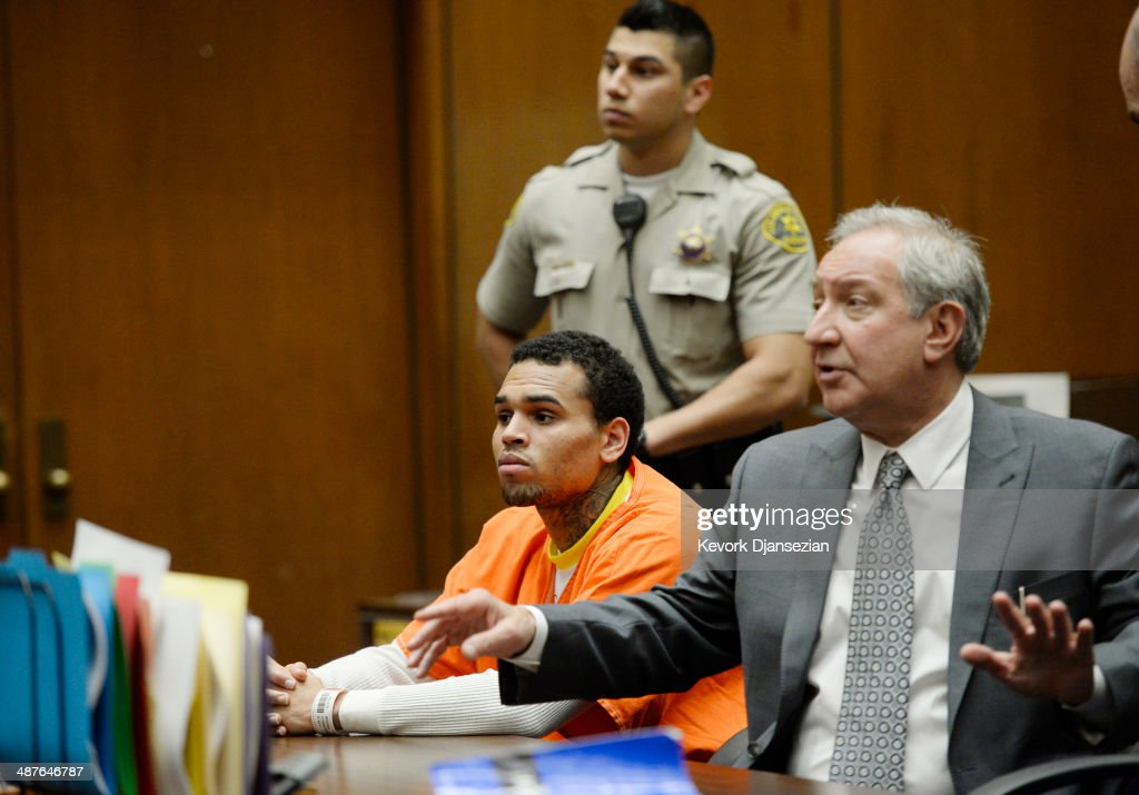 R&B singer Chris Brown (C) appears in court for a probation violation hearing with his attorney Mark Geragos (R) in Los Angeles Superior Court on May 1, 2014 in Los Angeles, California. Brown has been ordered to remain jailed without bail until another court hearing set for May 9. Brown has been on probation since pleading guilty to assaulting his then girlfriend, singer Rihanna, after a pre-Grammy Awards party in 2009. He has been in anger management treatment program and performing community service requirements. Brown and his bodyguard Christopher Hollosy are also facing misdemeanor simple assault charges after from an incident outside the W hotel in Washington D.C. last October.