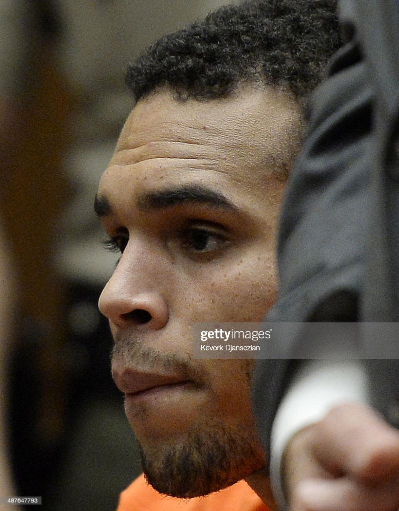 R&B singer <a gi-track='captionPersonalityLinkClicked' href=/galleries/search?phrase=Chris+Brown+-+Singer&family=editorial&specificpeople=4452016 ng-click='$event.stopPropagation()'>Chris Brown</a> appears in court for a probation violation hearing in Los Angeles Superior Court on May 1, 2014 in Los Angeles, California. Brown has been ordered to remain jailed without bail until another court hearing set for May 9. Brown has been on probation since pleading guilty to assaulting his then girlfriend, singer Rihanna, after a pre-Grammy Awards party in 2009. He has been in anger management treatment program and performing community service requirements. Brown and his bodyguard Christopher Hollosy are also facing misdemeanor simple assault charges after from an incident outside the W hotel in Washington D.C. last October.