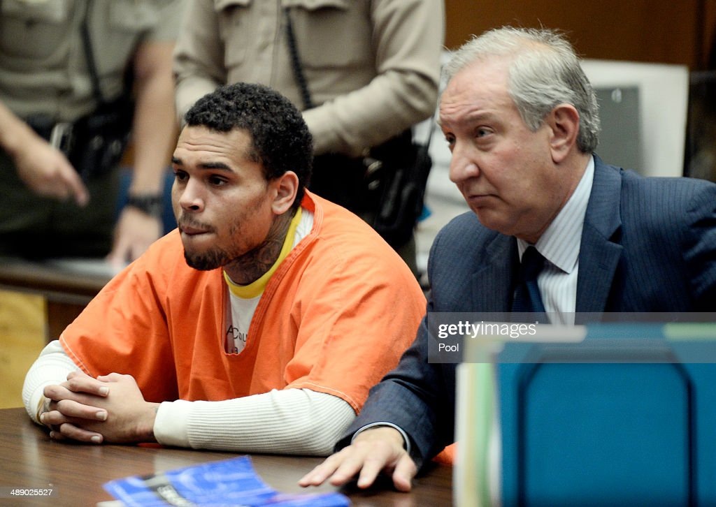 B singer Chris Brown appears in court for a probation violation hearing with his attorney Mark Geragos in Los Angeles Court on May 9 2014 in Los...