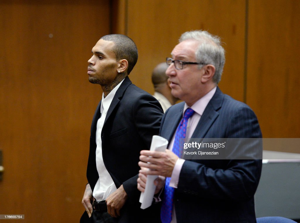 B singer Chris Brown appears in court with his attorney Mark Geragos for a probation violation hearing on August 16 2013 in Los Angeles California...