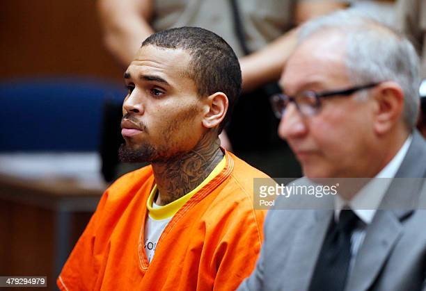 B singer Chris Brown appears in court with his attorney Mark Geragos for a probation violation hearing during which his probation was revoked by a...