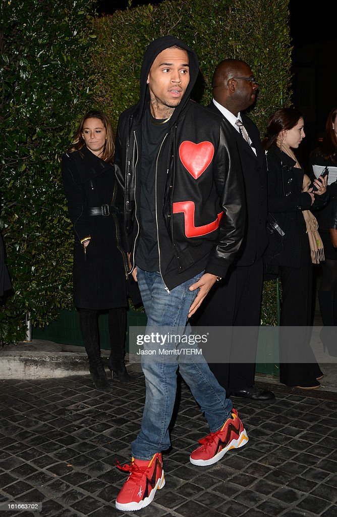 Singer Chris Brown arrives at the Topshop Topman LA Opening Party at Cecconi's West Hollywood on February 13, 2013 in Los Angeles, California.