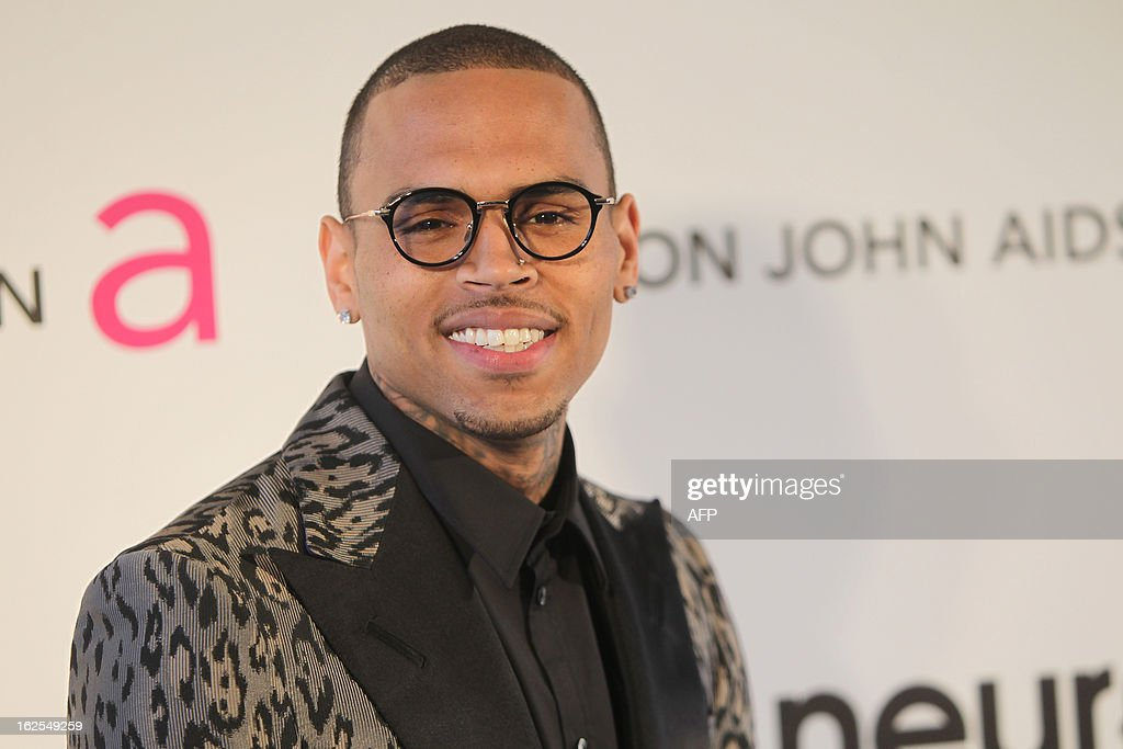 Singer Chris Brown arrives for the 21st Annual Elton John AIDS Foundation's Oscar Viewing Party on February 24, 2013 in Hollywood, California. AFP PHOTO/Mehdi TAAMALLAH