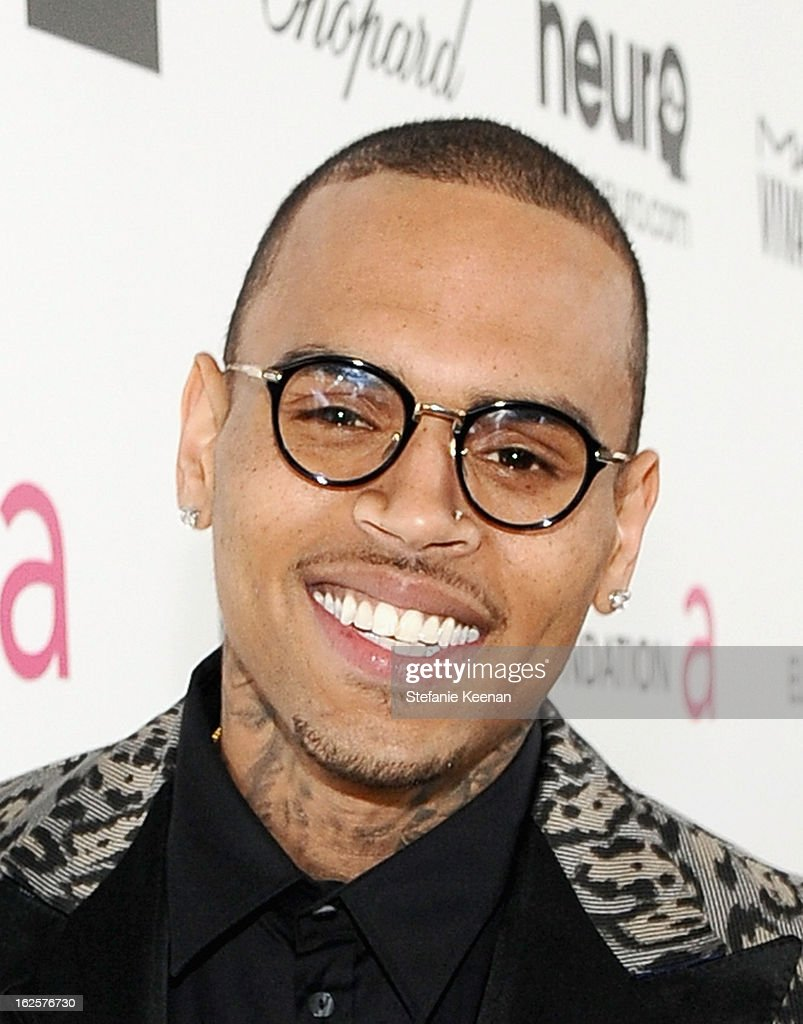 Singer Chris Brown attends Chopard at 21st Annual Elton John AIDS Foundation Academy Awards Viewing Party at West Hollywood Park on February 24, 2013 in West Hollywood, California.