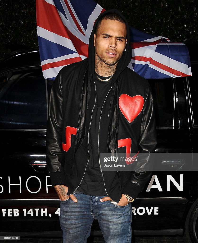 Singer Chris Brown attends the Topshop Topman LA flagship store opening party at Cecconi's Restaurant on February 13, 2013 in Los Angeles, California.