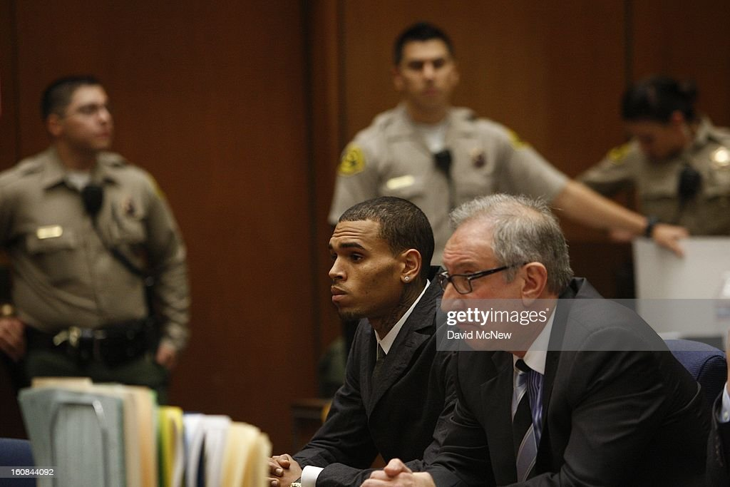 R&B singer Chris Brown (L) in court appears with his attorney <a gi-track='captionPersonalityLinkClicked' href=/galleries/search?phrase=Mark+Geragos&family=editorial&specificpeople=201725 ng-click='$event.stopPropagation()'>Mark Geragos</a> for a probation progress report hearing on February 6, 2013 in Los Angeles, California. Brown pleaded guilty to assaulting his girlfriend, singer Rihanna, after a pre-Grammy Awards party in 2009. Prosecutors have alleged that he has failed to meet the terms of his probation.