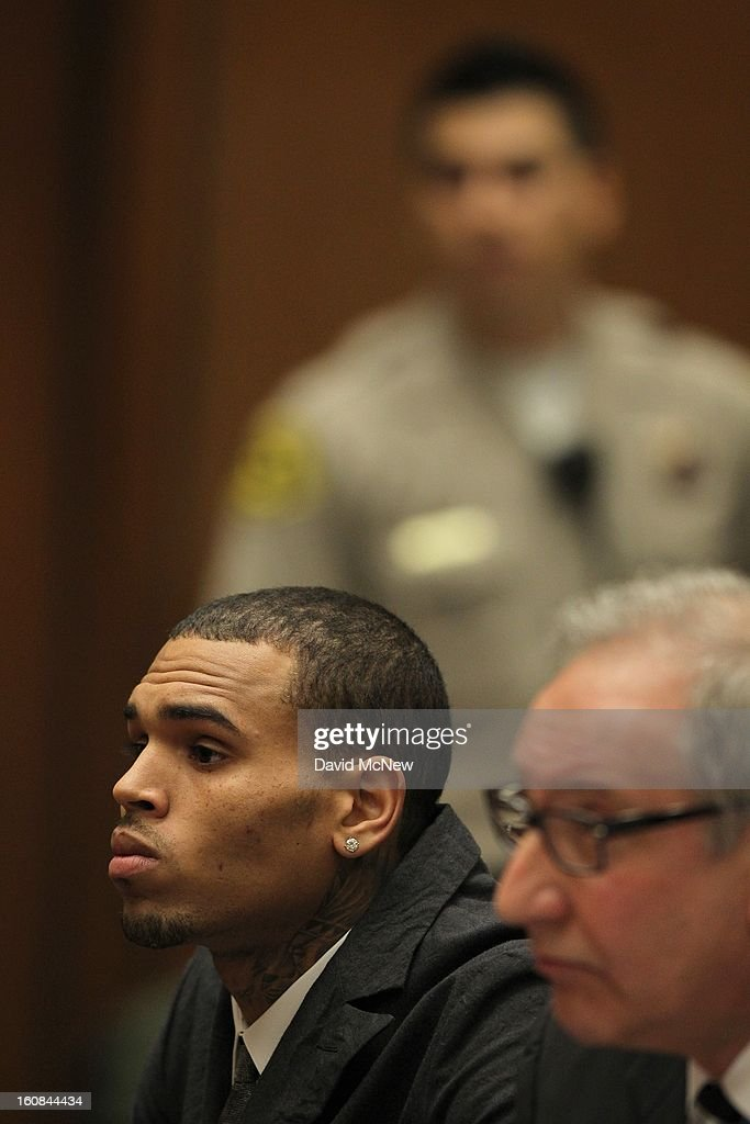 R&B singer Chris Brown in court appears with his attorney <a gi-track='captionPersonalityLinkClicked' href=/galleries/search?phrase=Mark+Geragos&family=editorial&specificpeople=201725 ng-click='$event.stopPropagation()'>Mark Geragos</a> (R) for a probation progress report hearing on February 6, 2013 in Los Angeles, California. Brown pleaded guilty to assaulting his girlfriend, singer Rihanna, after a pre-Grammy Awards party in 2009. Prosecutors have alleged that he has failed to meet the terms of his probation.