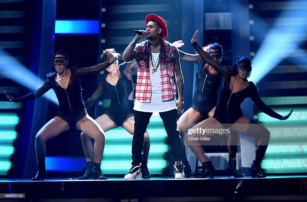 Singer Chris Brown performs onstage during the 15th Annual Latin GRAMMY Awards at the MGM Grand Garden Arena on November 20 2014 in Las Vegas Nevada