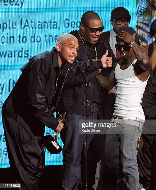 Singer Chris Brown rappers Busta Rhymes and Lil Wayne accept the Best Collaboration award onstage during the BET Awards '11 held at the Shrine...