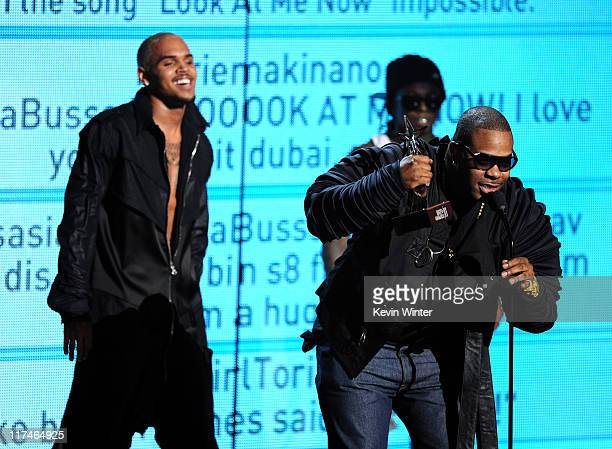 Singer Chris Brown rappers Lil Wayne and Busta Rhymes accept the Best Collaboration award onstage during the BET Awards '11 held at the Shrine...