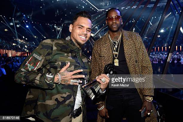 Singer Chris Brown winner of the award for RB Artist of the Year and rapper 2 Chainz pose backstage at the iHeartRadio Music Awards which broadcasted...