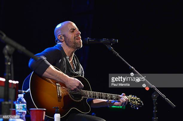 Singer Chris Daughtry performs at MIX 1041's 'Not So Silent Night' at Revere Hotel Boston Common on December 12 2013 in Boston Massachusetts
