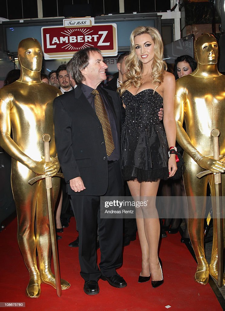 Singer Chris De Burgh and daughter <a gi-track='captionPersonalityLinkClicked' href=/galleries/search?phrase=Rosanna+Davison&family=editorial&specificpeople=2579566 ng-click='$event.stopPropagation()'>Rosanna Davison</a> attend the Lambertz Monday Night 2011 Schoko & Fashion party at the Alten Wartesaal on January 31, 2011 in Cologne, Germany.