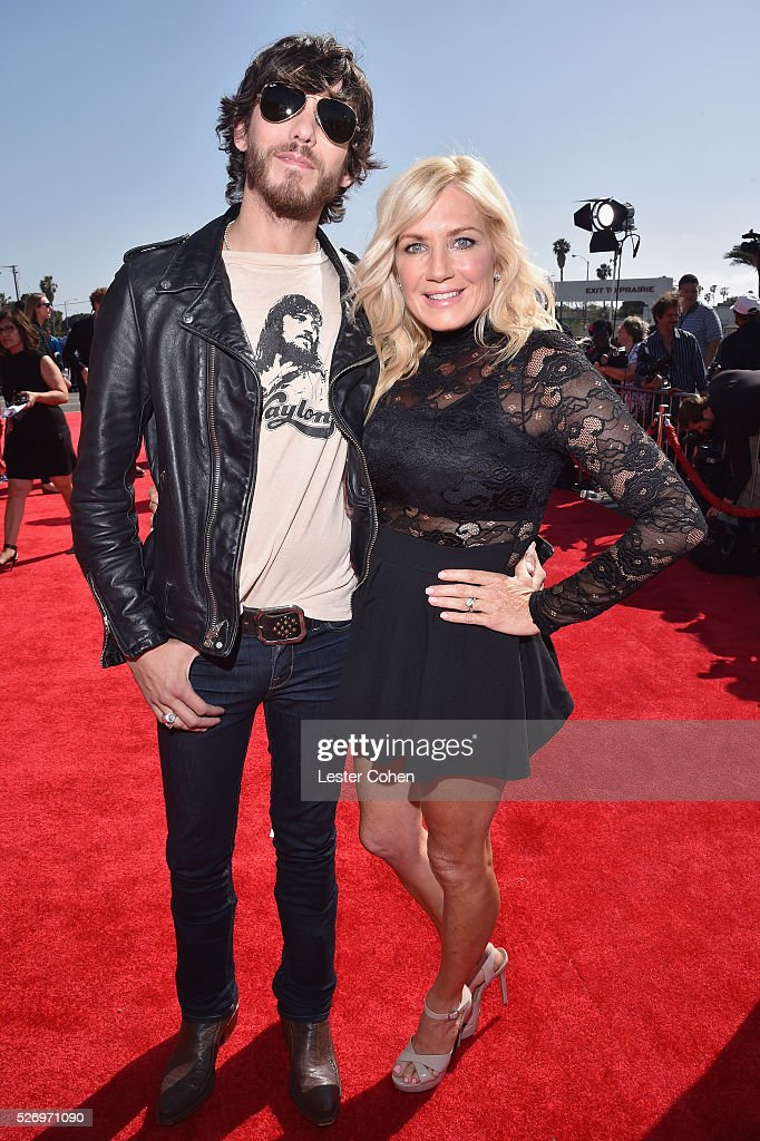Singer Chris Janson (L) and guest attend the 2016 American Country Countdown Awards at The Forum on May 1, 2016 in Inglewood, California.