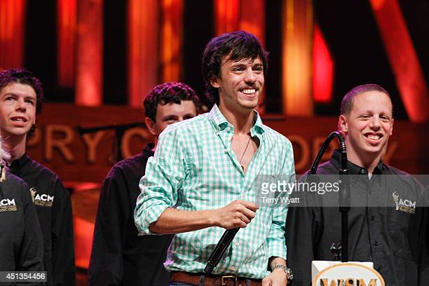 Singer Chris Janson is joined onstage by the ACM Lifting Lives Music Campers during ACM Lifting Lives Music Camp Performance On The Grand Ole Opry...